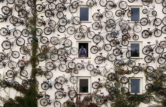 A bicycle shop in Altlandsberg, Germany advertises with 120 bikes on a wall.