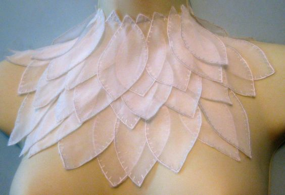 Steampunk jewelry ivory leaf textile bib detachable collar necklace. $39.00, via Etsy.