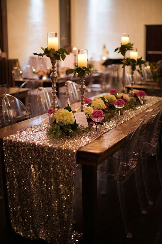 Sequin table runners are a jaw dropping table accessory that resemble a work of art. | See more trending table runner themes here: http://www.mywedding.com/articles/9-trending-table-runners-for-weddings/: