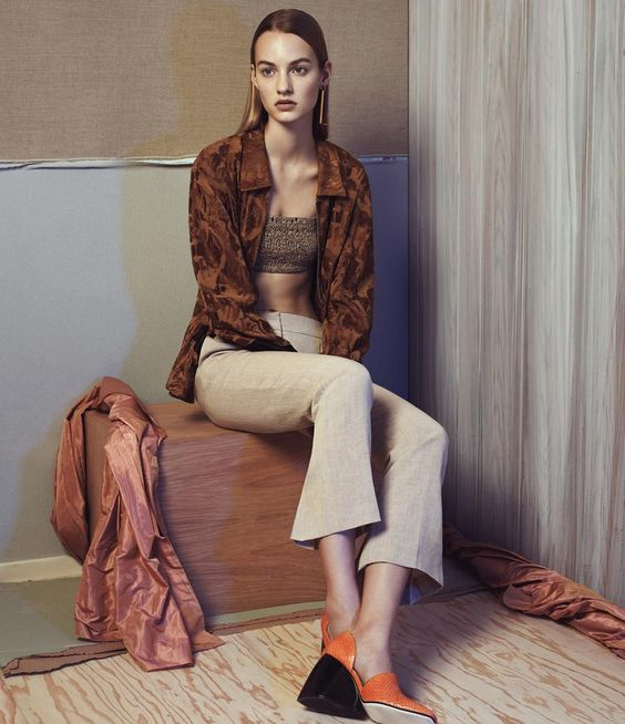 <strong>AGAINST THE GRAIN</strong> | Vintage-inspired fabrics such as silk jacquard gain new relevance when juxtaposed with raw linen or leather. Dries Van Noten bronze silk jacket, <em>$1,250, similar styles available at Bergdorf Goodman,</em> and bandeau, <em>Nancy,</em> Giorgio Armani linen pants, <em>$1,095, Giorgio Armani boutiques nationwide,</em> and Loewe pumps, <em>$1,090, Opening Ceremony New York</em>