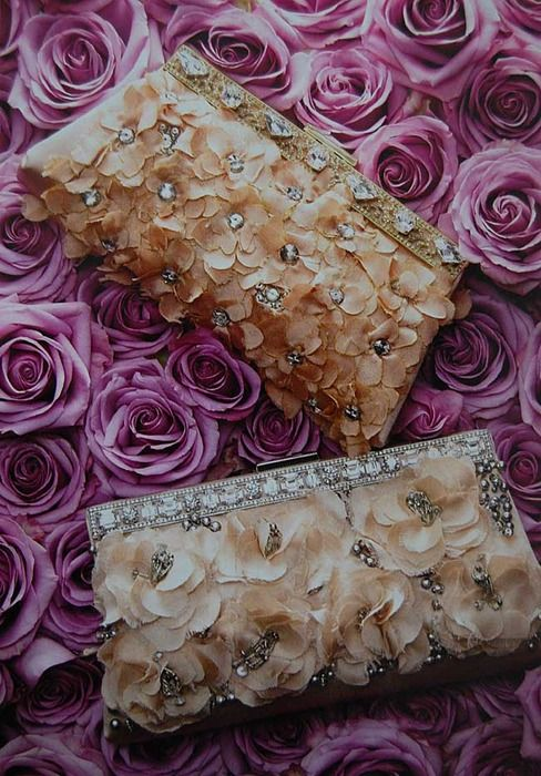 love these beautiful pale pink clutch purses with rhinestones....