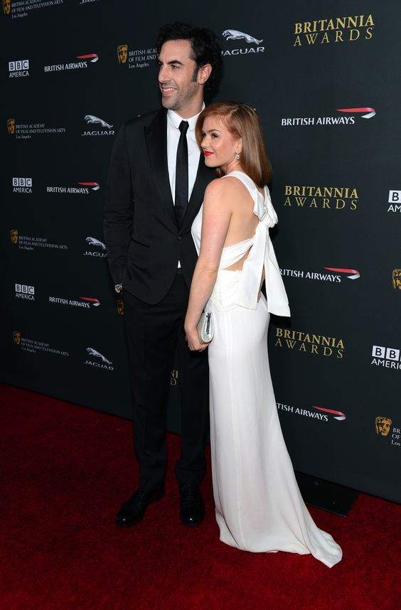Australian actress Isla Fisher wearing a Burberry Prorsum dress to attend the BAFTA LA Britannia Awards in LA