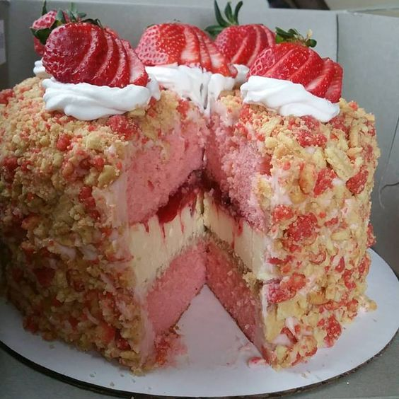 STRAWBERRY SHORTCAKE CHEESECAKE Ingredients:    Bottom crust  22 Golden Oreos Crushed  5 Tbsp Melted butter  Filling  4 8oz packages cream cheese  1 2/3 cups sugar  1/4 cup corn starch  1 Tbsp Pure Vanilla Extract  2 Large Eggs  3/4 Cup Heavy Whipping Cream  Jar of smuckers strawberry ice cream topping  Topping  12 Golden