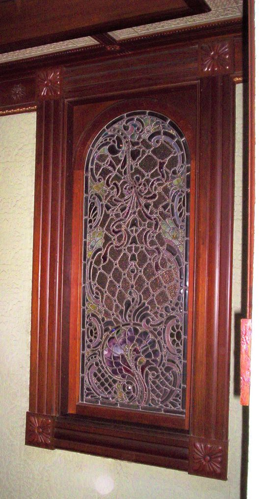 This is the most expensive art glass window in the house, purchased through Tiffany's of New York. Mrs. Winchester originally installed it in an outside wall, but later added a series of rooms that blocked off all direct sunlight. So the lovely stained glass sits now in darkness . . . like the $3,000 doors which were never used.