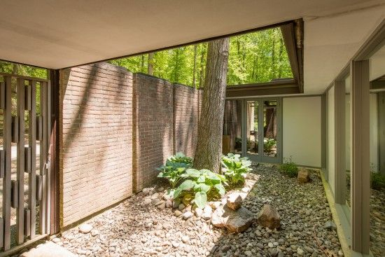 Price Drop Custom Mcm In Owings Mills 649k Architecture Courtyard Wood Beam Ceiling Mid Century Modern House