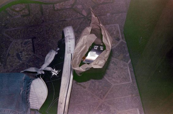 A box of shotgun shells are visible next to Kurt Cobain's foot from a newly released photo from the investigation of his suicide.