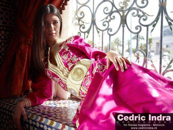 Turkish actress Tuba Bykushtun, wearing a fushia with gold broiding caftan.