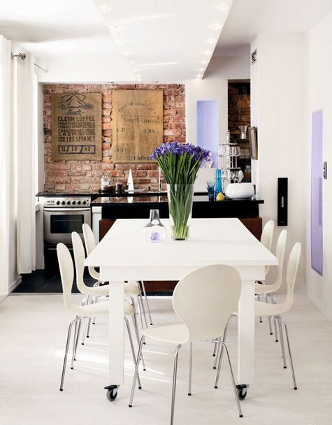 LOVE the exposed brick wall behind the stove...with everyone doing back-splashes and all kinds of granite, tile, etc. stuff these days, it is extremely refreshing. Plus the contrast is amazing!