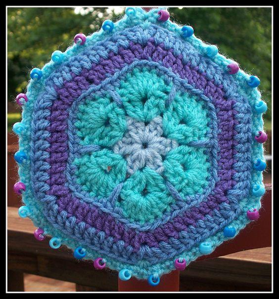 African Flower Crochet Wall Art by diddledaddledesigns, via Flickr