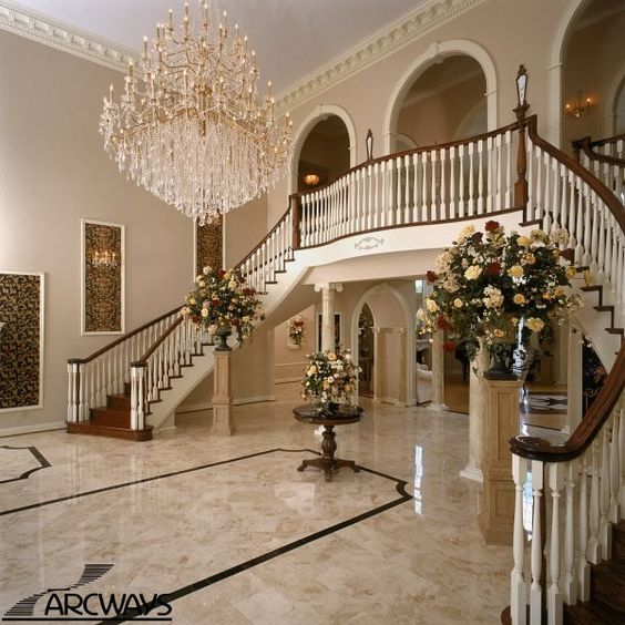 Grand Foyer : A grand foyer with symmetrical twin freestanding curved
