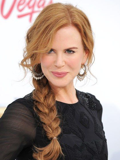 """Nicole Kidman To make a chunky three-strand braid look as fat as possible, Fugate suggests pushing the bottom elastic up toward the top of the braid. """"This diffuses the end and opens up the rest of the braid,"""" he says."""