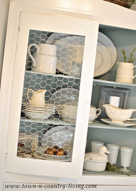 painted chicken wire for the cabinet fronts, instead of the expected glass