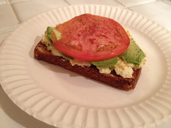 Egg salad on multigrain toast with avocado, tomato and pepper!