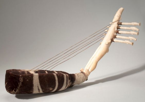 Africa   Harp from the Mangbetu people of Niangara, Belgian Congo   Ivory, Okapi fur, cord, sinew   ca. 1915