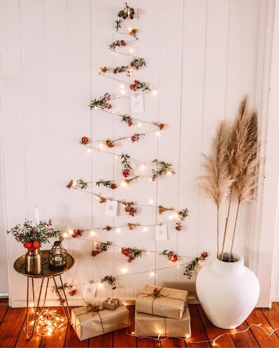 A Boho Wall Mounted Christmas Tree Of Lights Berries And Christmas Cards Plis Pampas Gras Wall Christmas Tree Wall Mounted Christmas Tree Cool Christmas Trees