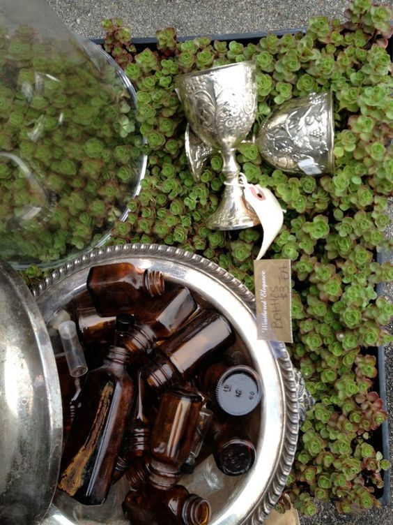 A flat of sedum was the perfect place to display silver and vintage glass bottles.