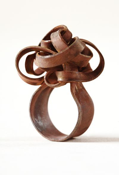iron ring.  You might not be able to lift your hand, but who needs to when you're wearing something so pretty?