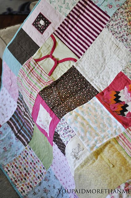 Quilt made of baby's clothes from first year