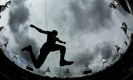 Image: Frances Benjamin Compaore participating in the mens triple jump qualifying round during the 2012 Summer Olympics in London (© David J. Phillip/AP Photo)