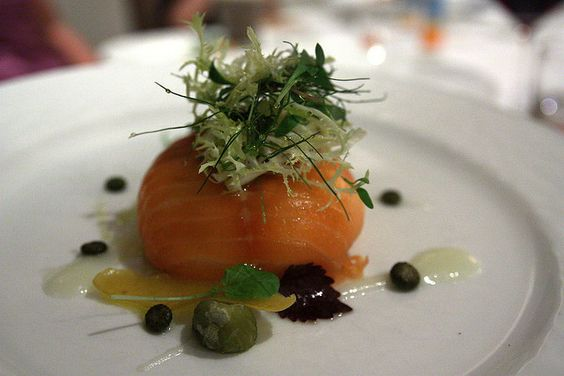 Mousseline de Morue  chilled mousse of cod wrapped in smoked salmon with lemon caper dressing and herbs