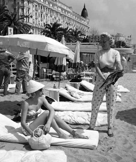 """"""" Read this story! """" beach of Cannes  about 1955-1959. photo: Kees Scherer"""