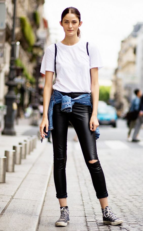 Timeless edgy combo // plain white tee with ripped leather pants. a denim jacket and black Converse sneakers