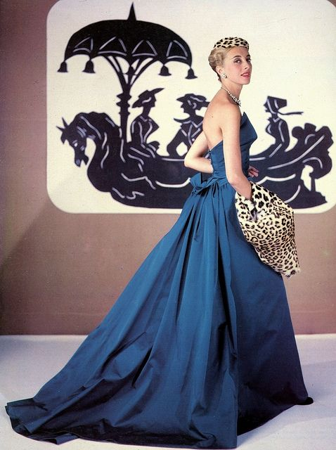 gown accented with leopard hat and muff, photo Pottier, 1953