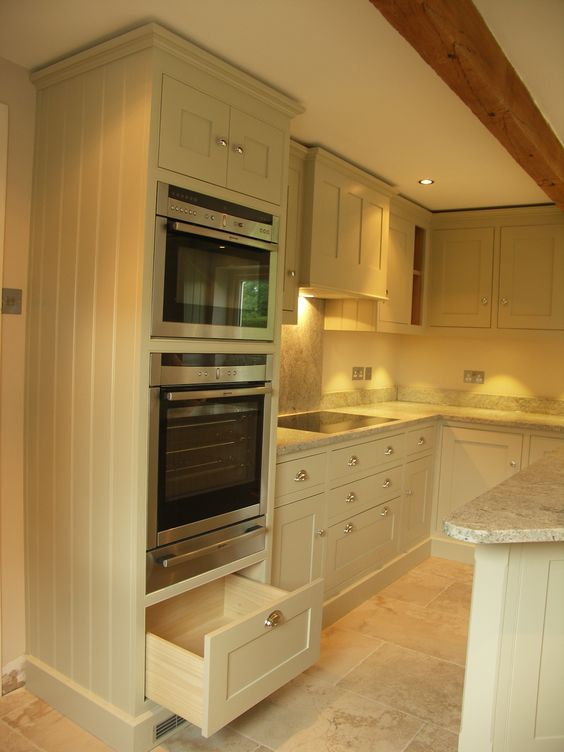 Stacking appliances really make great use of space for Bone white kitchen cabinets