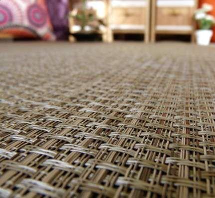 Espectacular perspectiva del trenzado de una alfombra de fibra