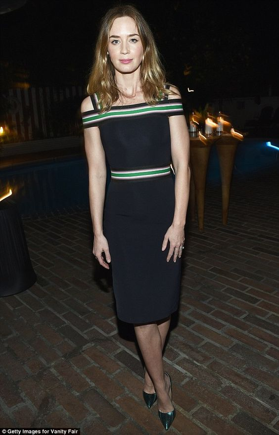 How does she do it? Emily showed off her enviably slim frame in a figure-hugging dress...