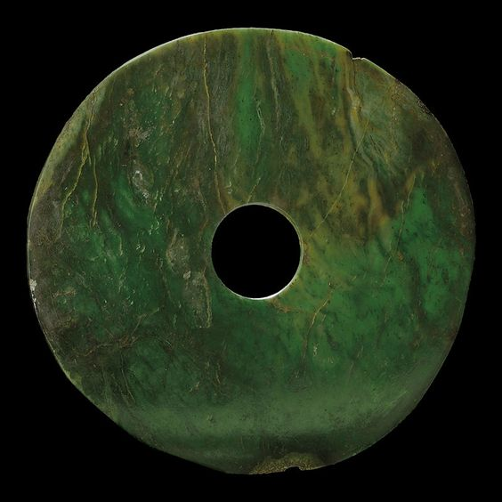 A very rare and unusually large dark green jade bi. Late Neothlitic period, northwest China, circa 2000 B.C.