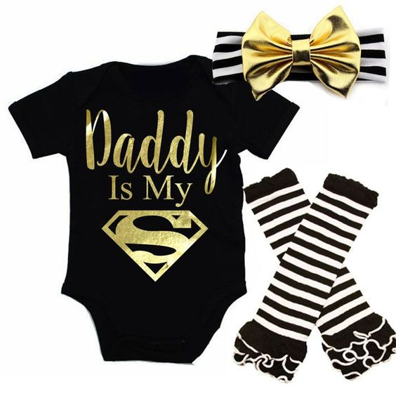 Black and Gold Daddy Is My Superman Baby Girl OutfitThis is an exclusive and original design by All That Glitters & Gold!Are you looking for something really cute and unique for your little one to come home from the hospital in or do you know someone who is expecting and want to get them to the cutest baby shower gift possible? Are you looking for something really cute for Fathers Day?If so, our Gold glitter I Get It From My Mama  baby girl outfit is the perfect item. It's cute, stylish and