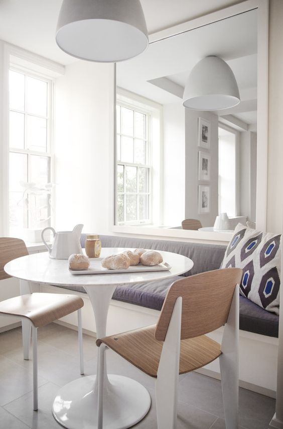Instead of a corner banquette, just line the one wall when there's not enough space.