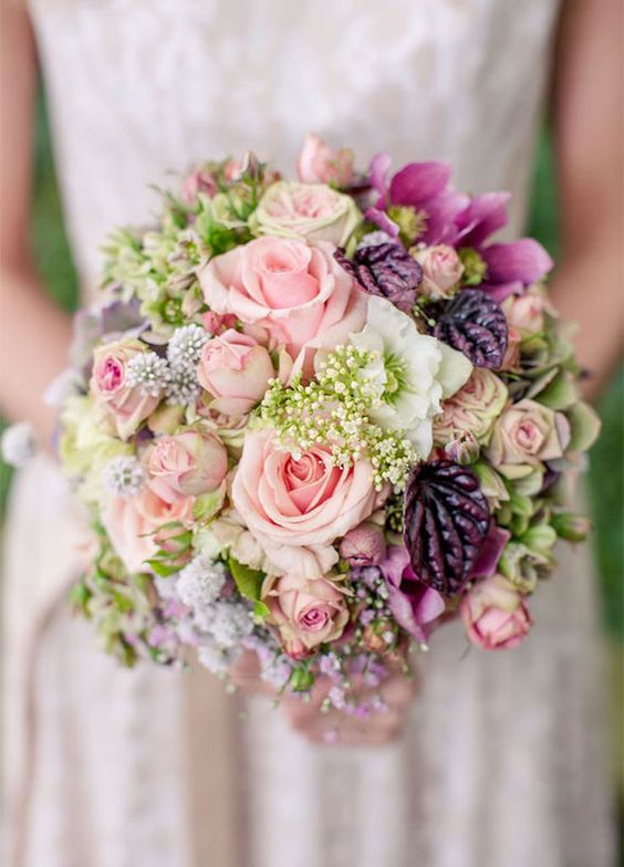 10 Insanely Pretty Spring Wedding Bouquets: Pink roses other mixed wild flowers look as if they were just picked from your garden. Photo by Alexander Hahn:
