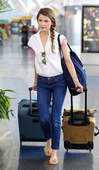 Airplane travel style -- breezy shirt tucked into jeans ...