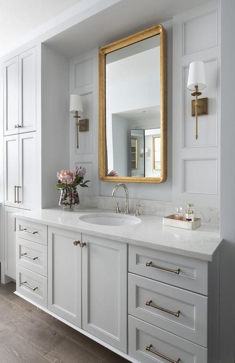 This Welcoming Gold And Gray Master Bathroom Features A Gray
