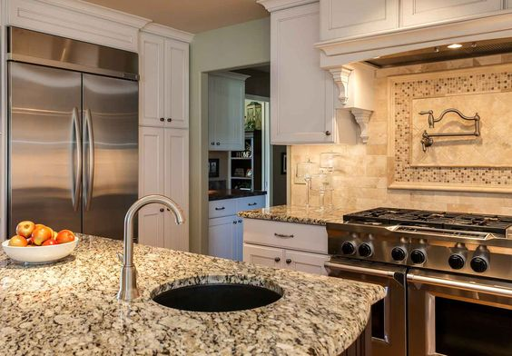 This kitchen was three rooms before, much too small and closed in. Older homesweren't built for the Colorado lifestyle of great rooms, and friends and fa