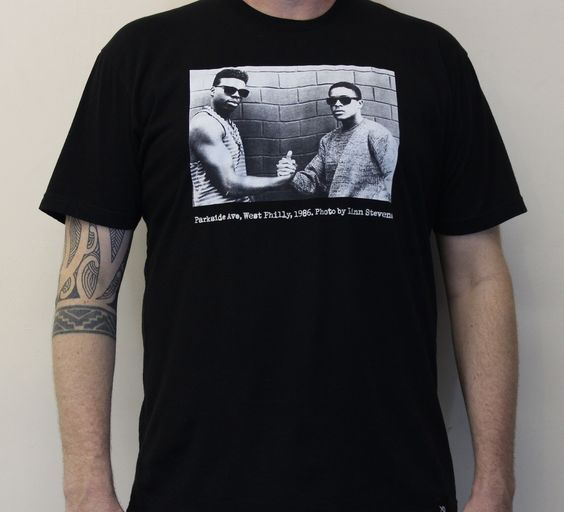 A portion of the profits from this shirt will be donated to a Philadelphia-based charity chosen by Schoolly-D: FACE TO FACE GERMANTOWN.From its origins as a soup kitchen in 1985, Face to Face has evolved into a multi-serv...