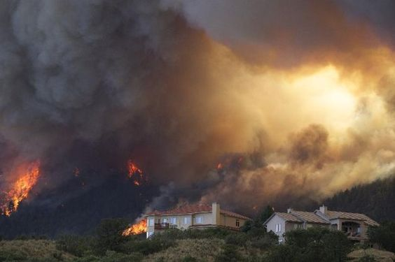 Fire from the Waldo Canyon wildfire as it moved into subdivisions and destroyed homes in Colorado Springs, Colo., on Tuesday, June 26, 2012. (AP Photo/Gaylon Wampler)