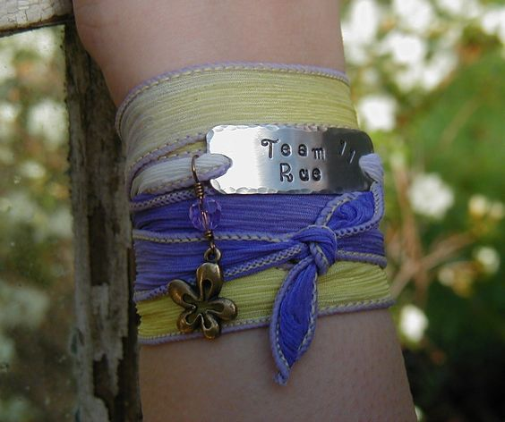 The Hunger Games Yellow and Violet SILK RIBBON Wrap Bracelet - Team Rue STAMPING. $19.99, via Etsy.
