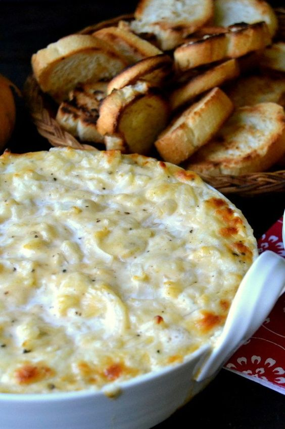 Photo of sweet vidalia onion dip with a basket of toasted bread in the background.