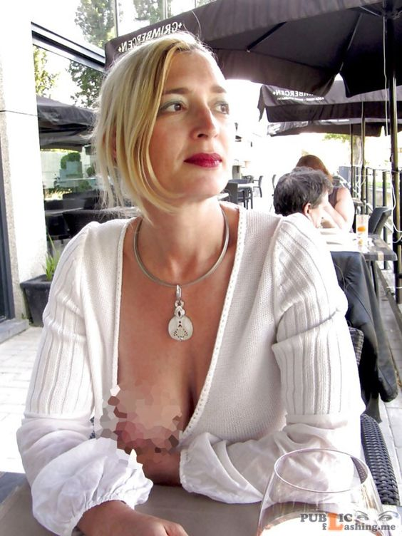 Nice looking blonde MILF nipple slip in outdoor cafe - Public Flashing