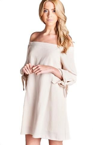 Off shoulder dress made of a luxurious soft woven fabric with adorable…