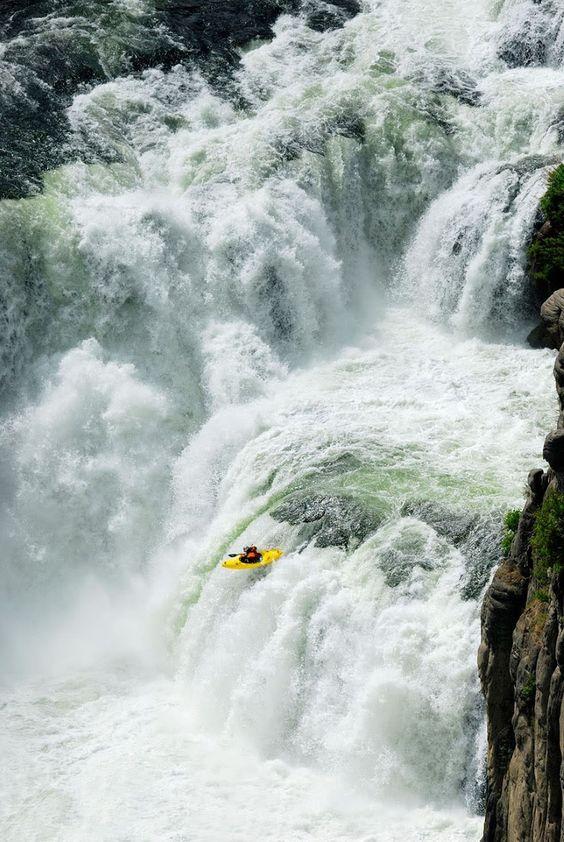 Kayaker plunges over the 65 foot tall Lower Mesa Falls near Ashton, Idaho