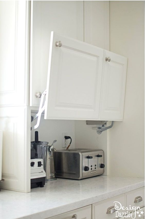 Today I am so excited to share one of my favorite aspects of the kitchen remodel. All the creative hidden kitchen storage solutions I was able to come up with! If there's one thing that makes cooking and baking more enjoyable, it's knowing that everything has a place and that you'll have easy access to...