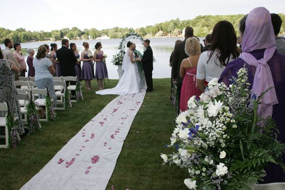 Married by the water, the mixture to the blue from the lake with the green in the grass then white of the Bride and flowers, timeless.