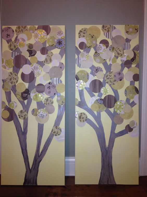 Fun and easy... I spray painted the canvas boards, painted the tree branches (used 3 different colors), cut different sizes and patterns of scrap book paper (used a circle punch), hot glue them on, lastly a matte finish mod podge