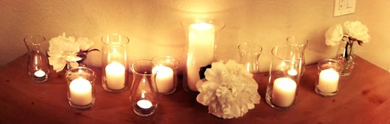 All candles and glassware from the Dollar Tree.  I snipped a few flowers from some fake stems I bought a Michaels.