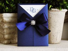 Sale - Elegant wedding Invitation with Navy metallic paper, rhinestone brooch and satin bow for the bride and groom for their wedding. $6.29, via Etsy.