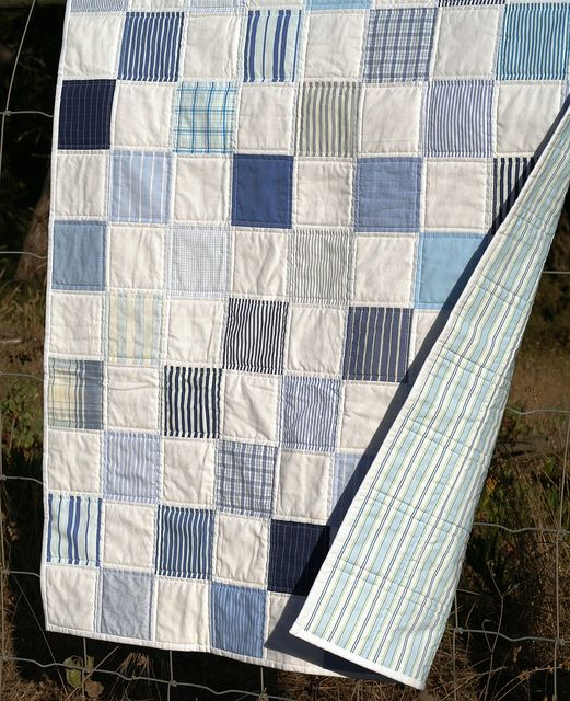 Men's cotton shirts made into patchwork quilt with striped sheet as backing. Great memory quilt to share with family or use for a baby boy. Easy straight line machine or hand quilting as shown in picture. DLW